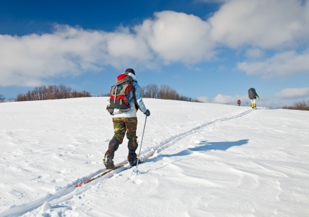 Mountain climbers in the winter photo