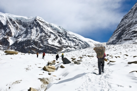 team of trekkers and porters in Himalaya mountains in Nepal