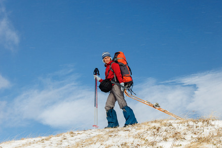 Young woman doing ski touring in winter mountains Stock Photo