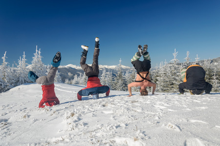 Group of skiers standing on his head on  mountain Stock Photo