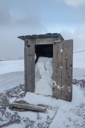 Wooden toilet box  of snow on the alps Stock Photo