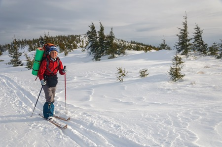 backcountry: A smily woman cross country skiing in the mountain