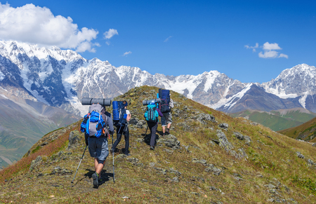 Group of trekkers in the summer mountains. Georgia, Svanetia. Stock Photo