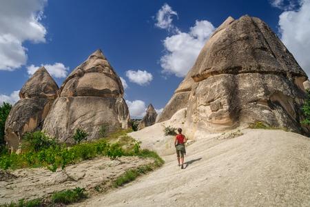 Yung girl walking in Love Valley of Cappadocia - Turkey