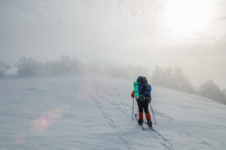 Man cross country skiing in the mountain
