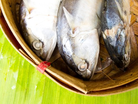 mackerel in basket on banana leaf photo