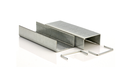 Stack of metal staples on a white background