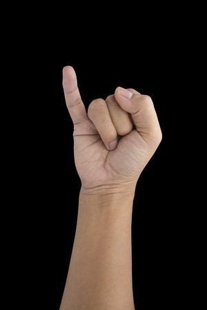 dedo meÑique: Hombre que hace un símbolo de la promesa del meñique aislado en negro con trazado de recorte Foto de archivo