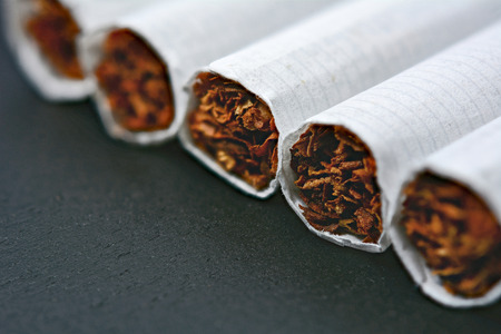 Closeup of cigarettes on black wooden table