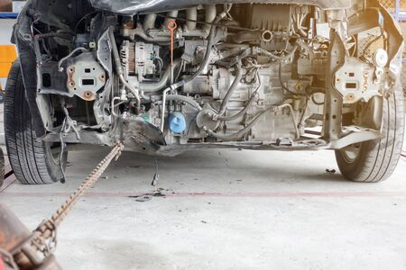 total loss: Auto repair on front after car accident - auto repair shop