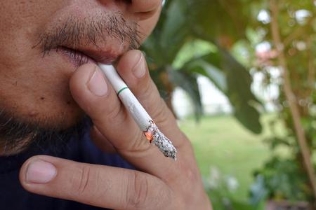 man smoking cigarette un healthy lifestyle Stock Photo
