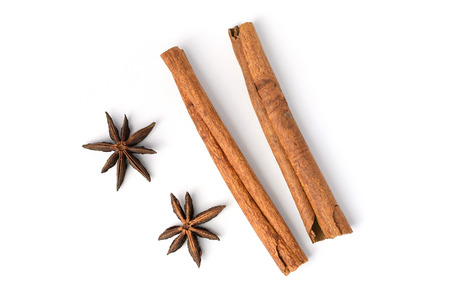Two brown vegeterian cinnamon sticks lying on a white background
