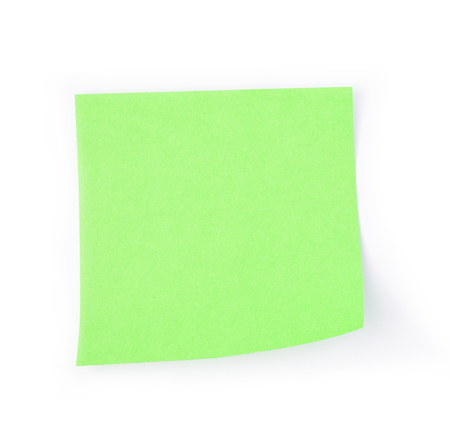 Green post it paper note on a white background