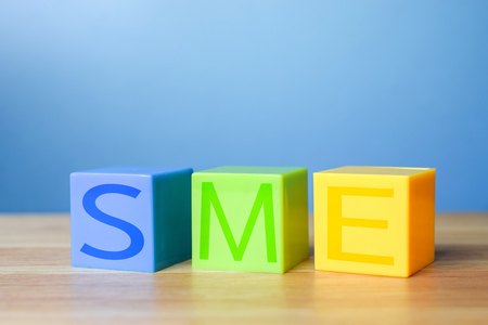 Colour blocks with SME on wooden table - Small and Medium Enterprise concept Stock Photo