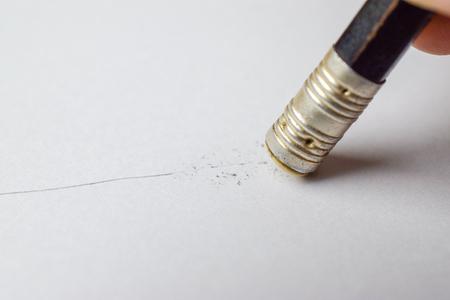 Artists hands eraser pencil line on paper. close-up Imagens