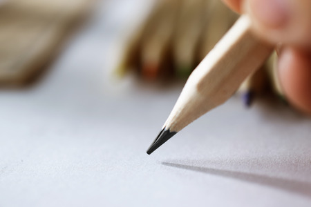 artists hand sketching with a simple pencil, close-up