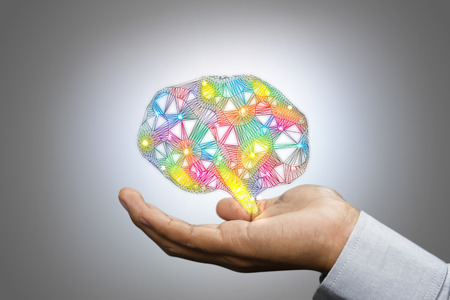 Colorful brain in man hand. Creative concept.
