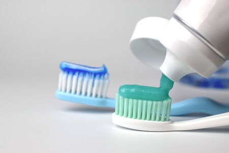 Toothbrush and toothpaste on blurred background Stock Photo