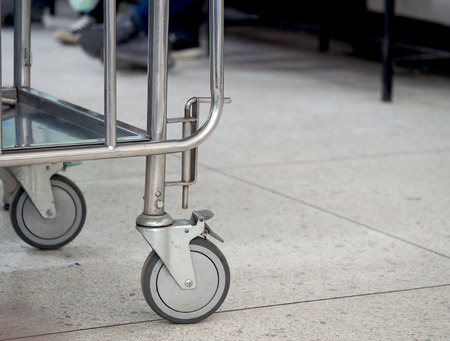 Stainless steel stretchers-lower part with wheels.