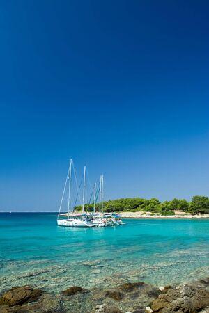 Sail boats docked in beautiful bay, Adriatic sea, Croatia
