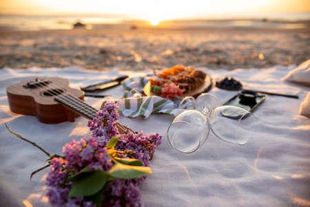 Picnic on Sunset. Picnic on Beach. Sushi set