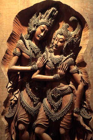 The art of wood carving that contains the figure of women and men. Stock Photo