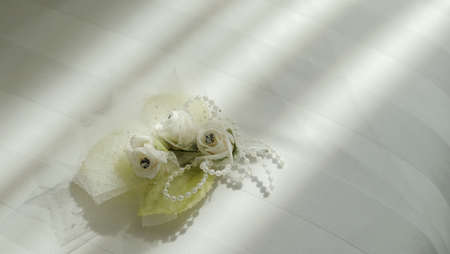 White corsage flowers with beads which are used for decoration or accessories on formal male clothes