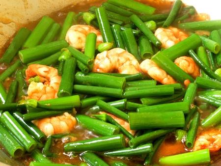 Close-up of colorful stir fry of shrimp Onion Flower Stem Stock Photo - 12955638