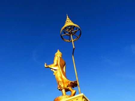 big standing golden Buddha against blue sky Stock Photo - 13086583