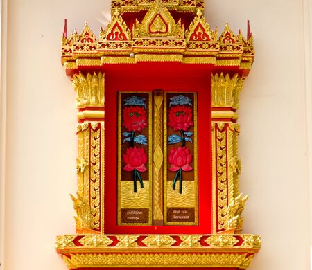 Thai Buddhist temple window, located in Surat Thani,Thailand