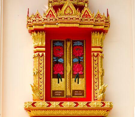 Thai Buddhist temple window, located in Surat Thani,Thailand