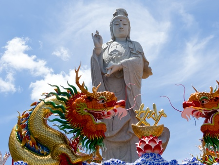 Big Standing Guan Yin and two dragon in Surat Thani,Thailand Stock Photo