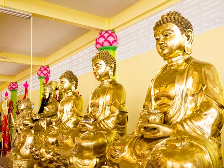 Golden buddha statue in Chinese temple inspire happiness fortune for human
