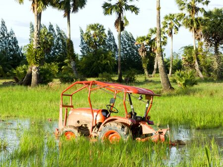 In south of Thailand a Tractor  parking in the field after prepare the seed before the rainy season   photo