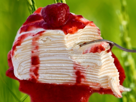 Crape Cake and sauce strawberry on the green background photo