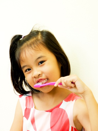 Asian girl brushing her teeth for beauty smile