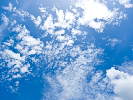 Blue Sky and Cloud Background under sun light Stock Photo
