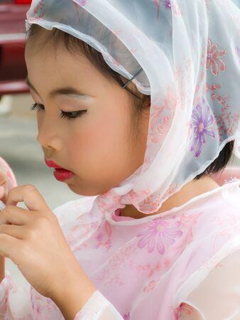Pretty Muslim girl dressing and wear scarf photo