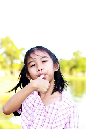 asian girl enjoy eating by her hand Stock Photo