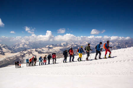 Russia, Elbrus - JULY 29, 2018: a Group of climbers lined up one after another go to the top of the mountain.every year thousands of tourists go to the mountains