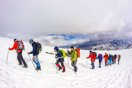 RUSSIA, Elbrus-JULY 29, 2018: a group of climbers follow each other in a chain to climb. Every year thousands of people go to the mountains.