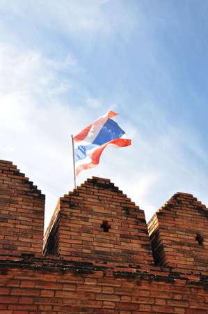 Thai flag on the bricks wall photo