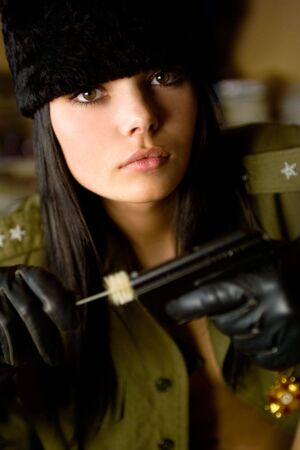 weapons: woman in military uniform clean personal weapons Stock Photo
