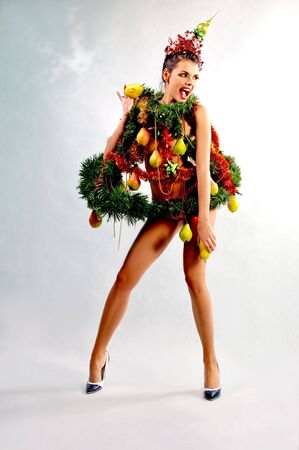 Girl in a unique New Year kosiumie pears garnished photo