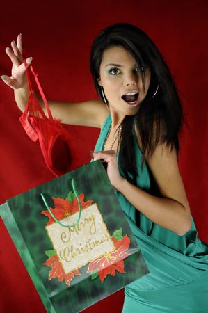 attractive woman in a green dress with a bag merry Christmas photo