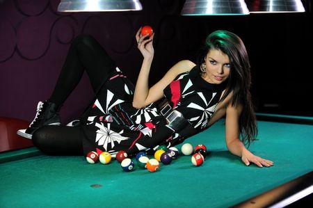 sexy woman posing on billiard table photo