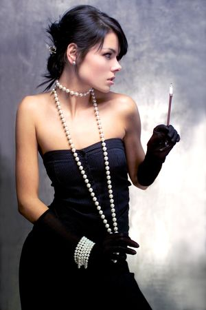 lofty: girl in a black dress and pearls with a cigarette