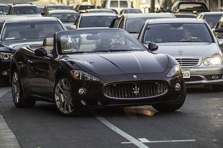 Maserati convertible pulling out into traffic in Los Angeles