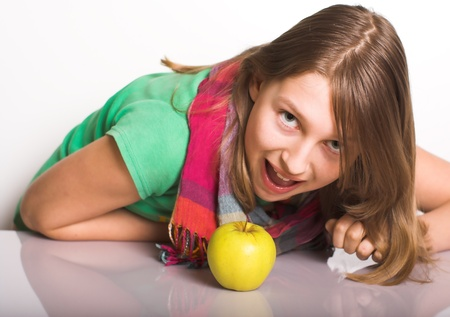sound bite: Teen attacks an apple like a tiger  Stock Photo