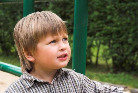 kinder garden: Little boy plays on the playground